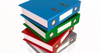 Administrative Procedures Binder: a pile of binderse