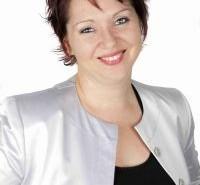 Headshot photograph of Anel Martin