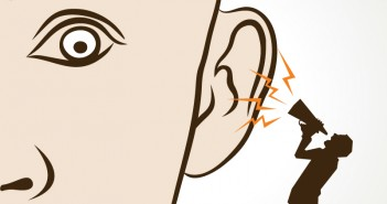 assertiveness: man shouting in another man's ear