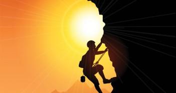 figure climbing a cliff