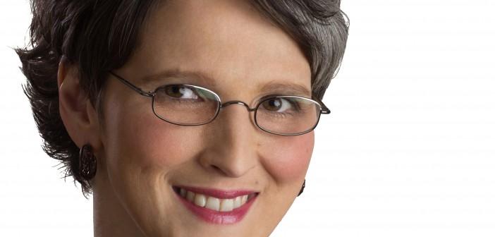 Headshot photograph of Julie Perrine