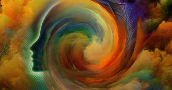 Super-human: profile face in a rainbow colour swirl of cloud