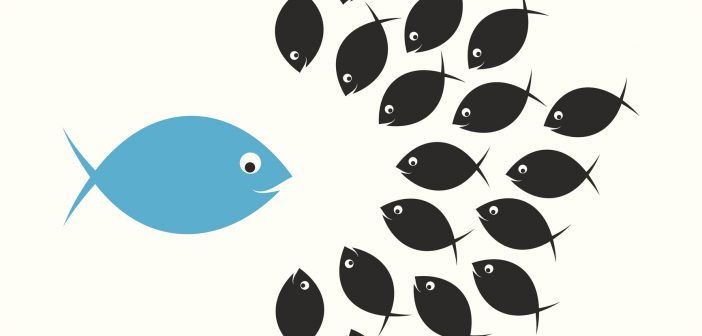 Large blue fish as speaker surrounded by a school of fish listening attentively