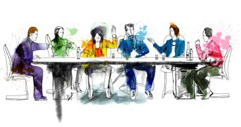 group of people around a meeting table