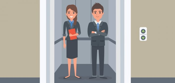 business man and woman standing inside an elevator