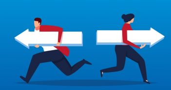 Male and female business people holding arrows run in different directions