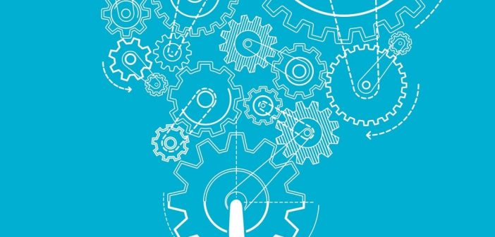 Finger pushing cogs to show career strategy