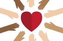 empathy - different coloured hands reaching for red heart