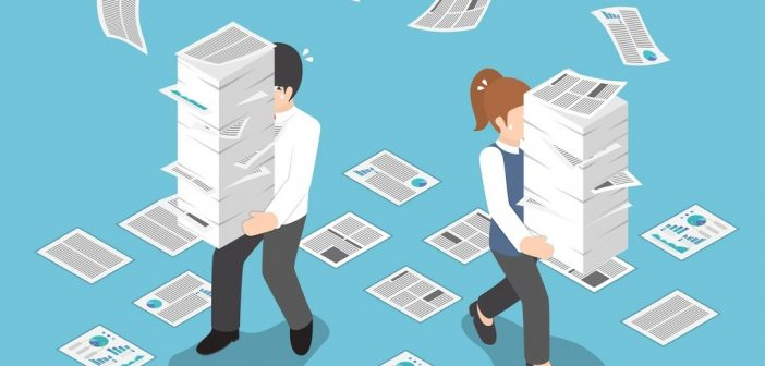 Control your workload: man and woman carrying stacks of paper