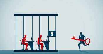 Open office: workers in a locked cage being unlocked