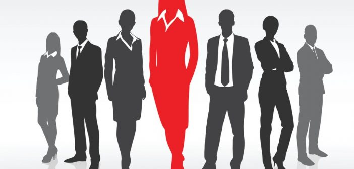 executive presence - business woman standing out from the crowd