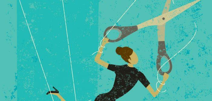 Career Break: woman cutting puppet strings